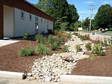 Stone swale alongside of a business -- Berkshire Design Group photo.